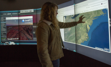 Photo of student interacting with the MultiTaction multi-touch iWall in the 370D CITL Visualization Lab